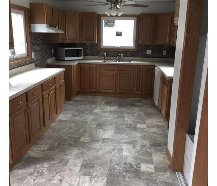 kitchen with new floors, cabinets, and appliances