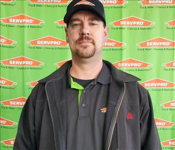 image of male employee standing in front of SERVPRO backdrop
