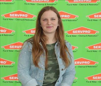 image of female employee standing in front of SERVPRO backdrop