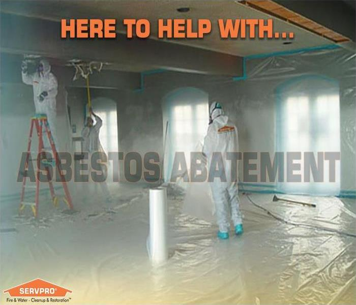 photo of workers in PPE suits performing asbestos abatement