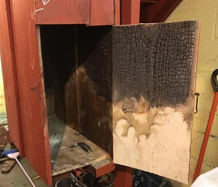 wooden door with soot and smoke damage