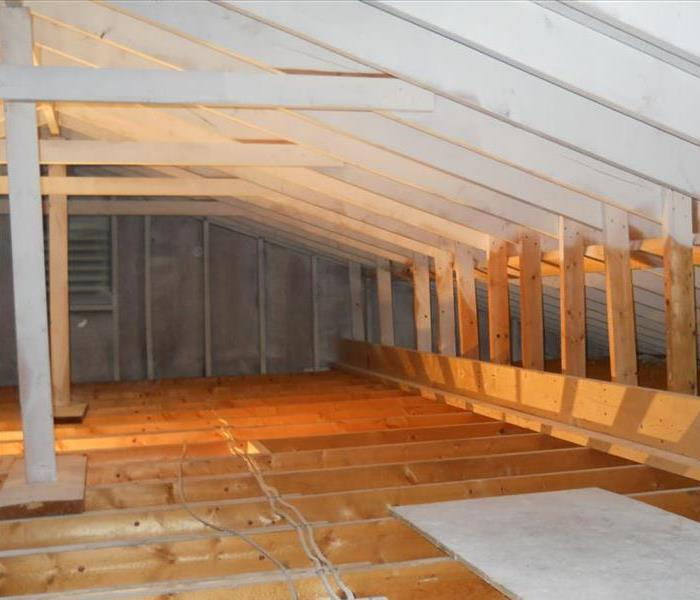 wooden attic with beams exposed and free of mold