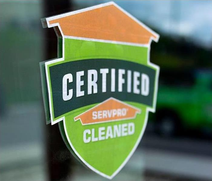 Image of Certified: SERVPRO Cleaned Program sticker on a glass door.