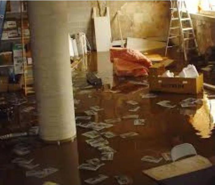 flooded basement with debris in about 2 inches of water