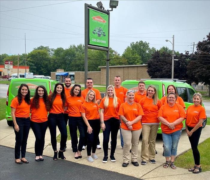 image of SERVPRO of Mercer County employees all wearing orange shirts