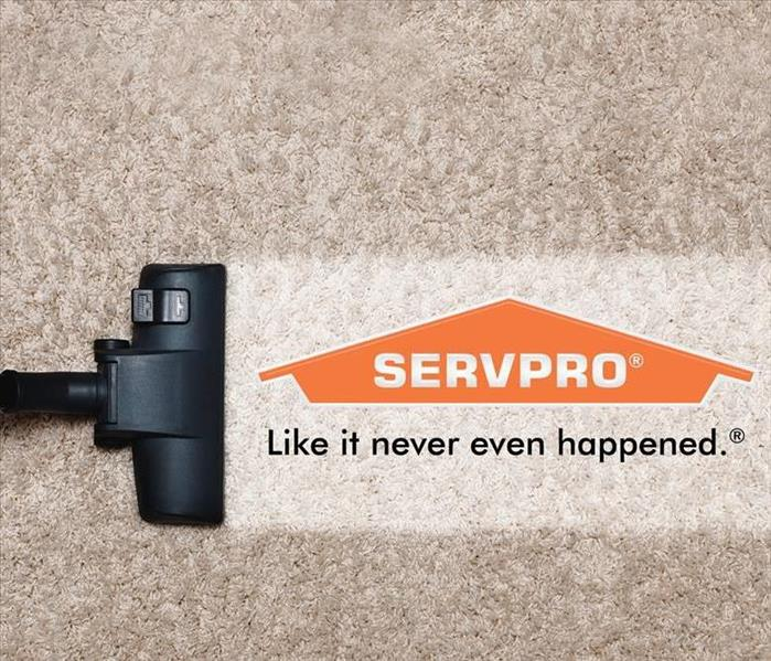 stock image of beige carpet being cleaned with SERVPRO logo and slogan